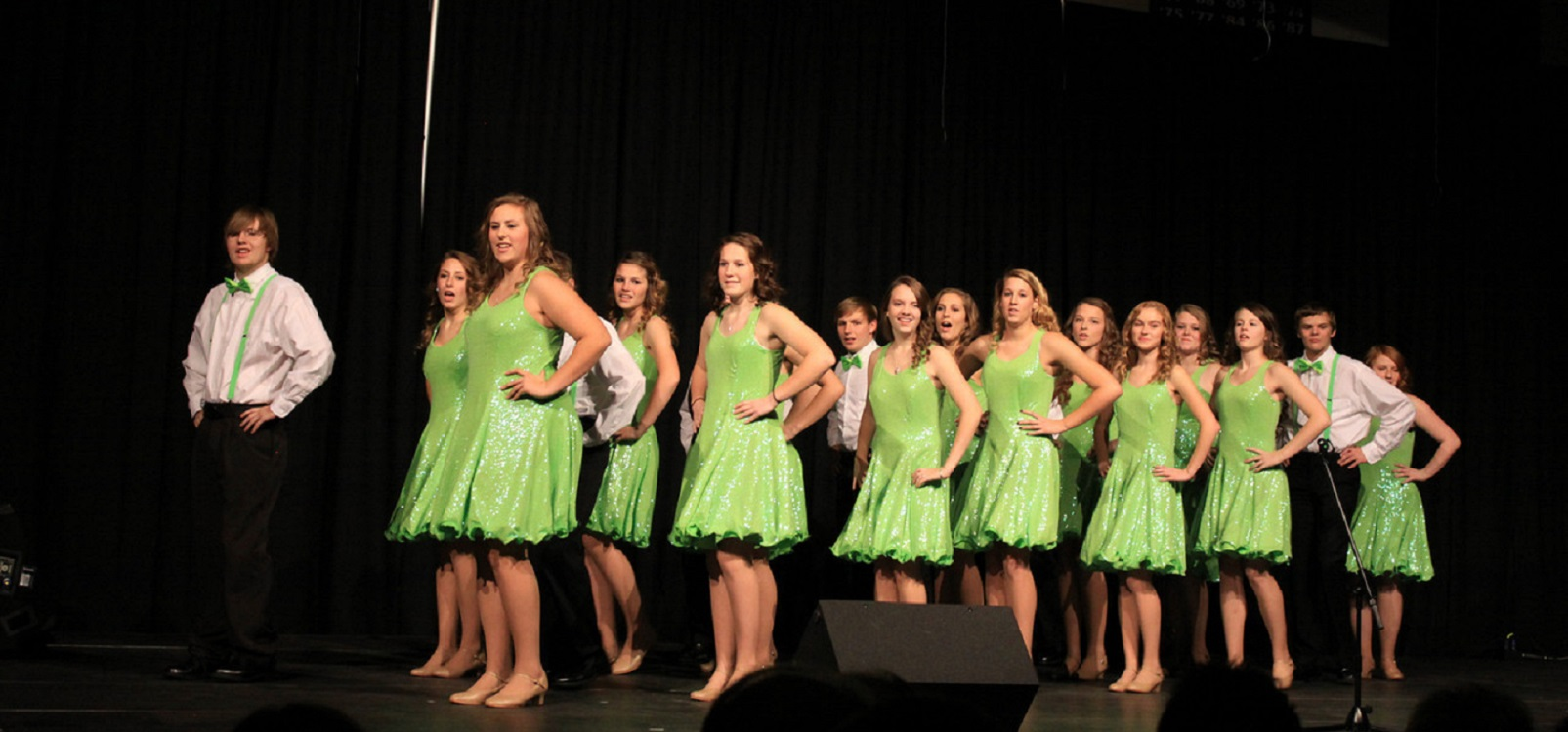 """<div class='slider_caption'> <h1>Hawk Singers</h1> <a class='slider-readmore' href='http://www.hvlhs.org/programs/fine-arts/'>This """"elite"""" group travels to several churches around the area to sing for HVL Sundays.</a> </div>"""